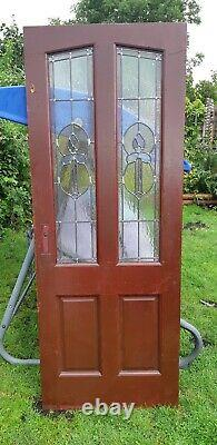 Hardwood front door with stained glass